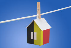 Belgian flag on paper house. Concept - Belgian flag painted on a paper house hanging on a rope Royalty Free Stock Photo