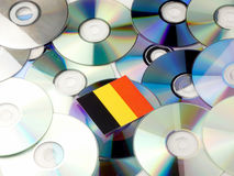 Belgian flag on top of CD and DVD pile isolated on white. Belgian flag on top of CD and DVD pile isolated Stock Images