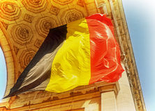 Belgian flag in Triumphal Arch in Cinquantenaire Park in Brussels Stock Image