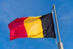Belgian flag waving against blue sky. In Boulogne sur Mer, France stock photo