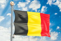 Belgian flag waving in blue cloudy sky, 3D rendering Stock Photography