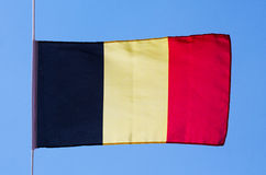 Belgian flag in wind against the sky Royalty Free Stock Photography