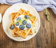Belgian golden waffles for breakfast with fresh Royalty Free Stock Photos