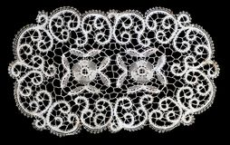 Belgian Lace. Piece of Belgian lace, on a black background stock image