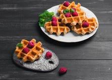 Belgian lush round waffles with fresh raspberries Royalty Free Stock Photo