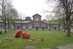 Belgian old mining site turned into museum. Grass. Flowers. Cloudy day. Trees royalty free stock photo