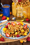 Belgian pumpkin waffles decorated with fresh fruits Stock Image