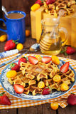 Belgian pumpkin waffles decorated with fresh fruits Royalty Free Stock Photo