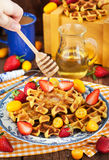 Belgian pumpkin waffles decorated with fresh fruits Stock Images
