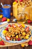 Belgian pumpkin waffles decorated with fresh fruits Stock Photos