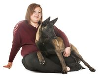 Belgian shepherd malinois and woman. In front of white background Stock Photography