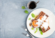 Belgian soft waffles with blood orange, cream, marple syrup and mint  on white plates Stock Image