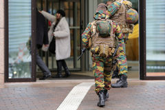 Belgian soldiers guard European institutions backs. Belgian soldiers guard European institutions. Unrecognisable people in uniforms. Security measures after the stock photo