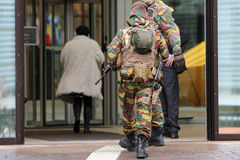 Belgian soldiers guard European institutions backs. Belgian soldiers guard European institutions. Unrecognisable people in uniforms. Security measures after the royalty free stock photos