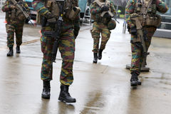 Belgian soldiers guard European institutions legs. Belgian soldiers guard European institutions. Unrecognisable people in uniforms. Security measures after the Royalty Free Stock Photo
