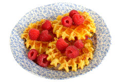 Belgian Style Waffles with Fresh Raspberries and Syrup. On a plate isolated white background Royalty Free Stock Image