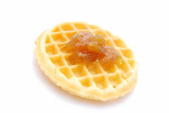 Belgian waffle with apricot jam Royalty Free Stock Images