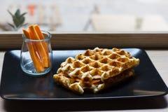 Belgian waffle with bacon, mozzarella, tomato. Stock Image