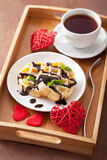 Belgian waffle with chocolate raspberry and hearts for Valentine Royalty Free Stock Images