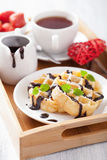 Belgian waffle with chocolate raspberry and hearts for Valentine Royalty Free Stock Image
