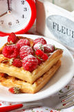 Belgian waffle. Delicious Belgian waffle with fresh berries for breakfast Royalty Free Stock Images