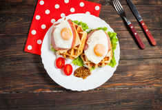 Belgian waffle with egg and salmon on wood table Royalty Free Stock Image
