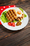 Belgian waffle with egg and salmon on wood table Royalty Free Stock Images