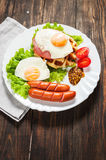 Belgian waffle with egg and sausage on wood table Stock Photos