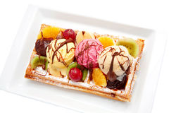 Belgian waffle with fruit, ice cream, chocolate. Stock Photo