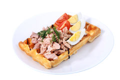 Belgian waffle with ham, boiled egg and tomato on white. Royalty Free Stock Photos