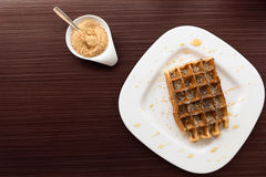 Belgian waffle with honey Royalty Free Stock Images