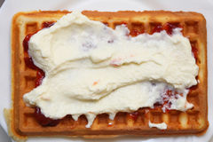 Belgian waffle with jam and whipped cream Royalty Free Stock Photography