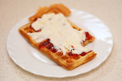 Belgian waffle with jam and whipped cream Stock Photos
