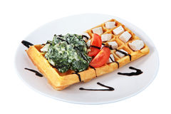 Belgian waffle with lettuce, cheese and tomato slices. Stock Photography