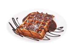 Belgian waffle with melted chocolate and coconut isolated on white. royalty free stock image
