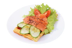 Belgian waffle with sliced salted salmon, tomatoes, cucumbers, l Stock Photography