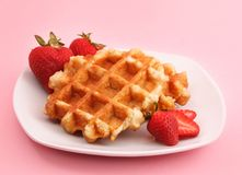 Belgian waffle and strawberries Stock Image