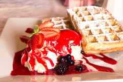 Belgian waffle with strawberry ice cream Royalty Free Stock Images