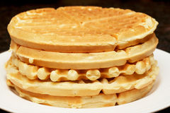 Belgian waffles. Stack of belgian waffles on white plate Stock Image