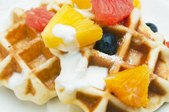 Belgian waffles. And fruits for breakfast Royalty Free Stock Image