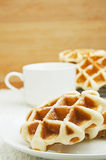 Belgian waffles. Freshly baked Belgian waffles and a cup of coffee Royalty Free Stock Photos
