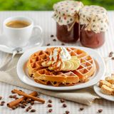 Belgian waffles with bananas and whipped cream Royalty Free Stock Images