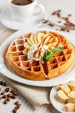 Belgian waffles with bananas and whipped cream Royalty Free Stock Image