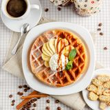 Belgian waffles with bananas and whipped cream Stock Images
