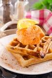 Belgian waffles. With icecream and orange Stock Photo