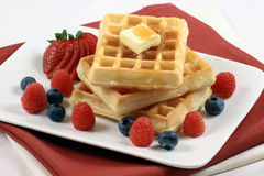 Belgian waffles with berries. Healthy sweet  decadent belgian waffles garnished with organic berries Royalty Free Stock Photo