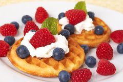 Belgian waffles with berries and cream Stock Photography