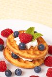 Belgian waffles with berries and cream stock photos