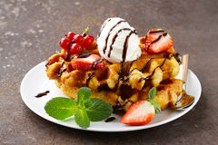 Belgian waffles with berries (currants, strawberries) Royalty Free Stock Photo