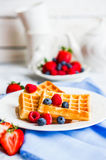 Belgian waffles with berries on rustic background Royalty Free Stock Photos